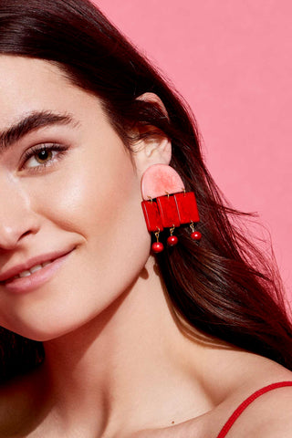 Roberta Earrings in Red by Shicato Spring 2018. Statement making red earrings made from tagua nut with closure slip fastening. Please handle delicately and lovingly.  Lightweight and hand cut.  Measurements 5.5 cm