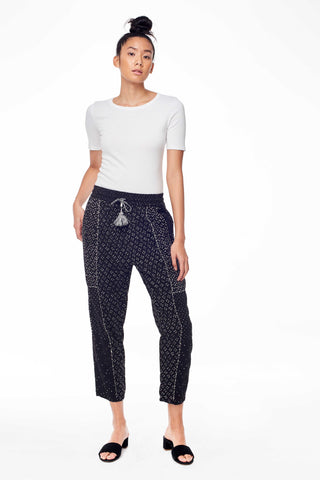 "Ulla Johnson Pre-Fall 2018 Kali Pant in Noir. Printed patchwork shibori cotton drop rise pant. Hand stitched seams, wide elastic waist with handmade two tone tassels, tapered silhouette, unlined. Size 4 inseam measures 25"". Color Black. Handmade in India. 100% cotton gauze. Sizes 2 4 6 8."