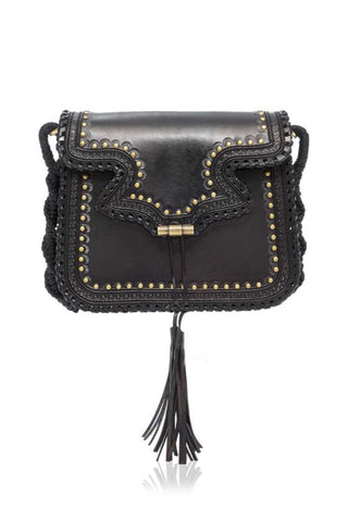 "Ulla Johnson Pre-Fall 2018 Esti Shoulder Bag in Noir. Classically hand embossed leather saddle bag. Hand macramed cotton crossbody strap, leather tassel detailing, brass hardware, inner pocket, cotton lining. 20"" Shoulder strap drop. 9 inches wide by 8 inches tall. Color black. 100% Leather. One size."