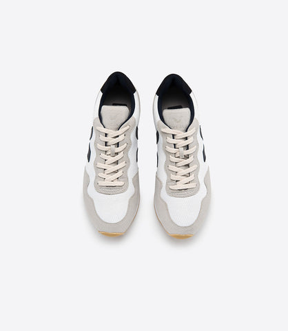 Santos Dumont Natural Mesh Sneaker by Veja Spring 2018. The B-Mesh used by Veja is made from recycled plastic bottles. 3 plastic bottles are used to create a pair of sneakers. This upcycling process creates a smart fabric, both breathing and waterproof. Upper in B-mesh. Vegan nubuck sections. Lining in Jersey (100% recycled polyester). Logo V made of wild rubber. Inner sole made out of organic cotton and expanded PU. Sole made of wild rubber from the amazonian forest (60%). Size 37 38 39 40 41.