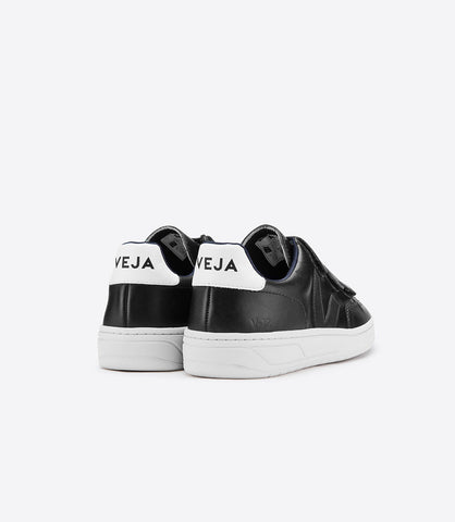V-12 3-Lock Velcro Black Leather Sneaker by Veja Spring 2018. 3-Lock Velcro Black Leather Sneakers by Veja. Upper in leather. Lining in Jersey (100% recycled polyester). Logo V made of wild rubber. Inner sole made out of organic cotton and expanded PU. Sole made of wild rubber from the amazonian forest (60%). Size 37 38 39 40 41.