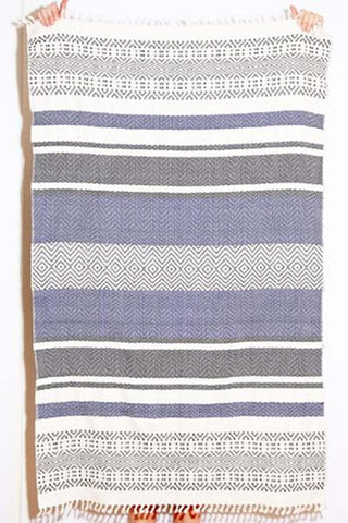 "Ixchel Beach Blanket by Wax + Cruz. 100% cotton beach blanket handwoven by master-artisans in Mexico. This unique piece does perfect double duty as a wrap, towel, or home textile. This towel seamlessly goes from picnic, to pool to beach. Fair trade Handwoven 37"" x 57"" Hand wash cold, hang to dry"