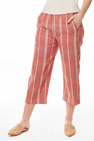 Wax and Cruz Spring 2018 Haydee Pant in Rust Stripe. Ankle cropped pant sewn from light weight handwoven cotton for max comfort. Elastic waist, trouser pockets in front, two patch pockets in back. Unlined. Size Small/Medium measures 34.5 inches from waist to hem. Color red and white stripe. 100% cotton. Sizes Small/Medium Medium/Large.