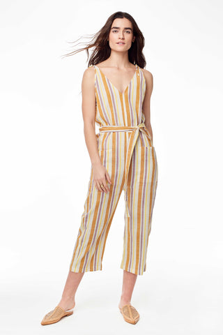 Wax and Cruz Spring 2018 Cabiria Jumpsuit in 70's Stripe. Soft handwoven cotton and sexy shoulder ties. V-neckline with removable matching tie wasit belt. Loose fitting with front patch pockets on trouser. Ankle crop. Unlined. Small/Medium measures 50.5 inches from shoulder to hem. Color yellow stripe. 100% cotton. Sizes Small/Medium Medium/Large.