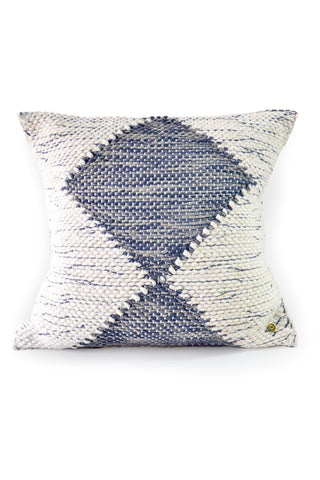 Blue Diamond Wind Pillow by Wayil. Handwoven in Guatemala. Exquisitely handmade on a traditional foot loom. This pillow pairs the cozy warmth of cotton with a chunky weave that highlights a modern character. Color white blue. 100% cotton.