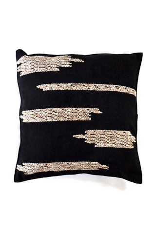 Nubes Pillow by Wayil. Handwoven in Guatemala. The Nubes pillow in earthy hues is hand weaved in foot loom. Zig Zags and asymmetrical designs highlight a natural and soft touch that provides a modern finish. Color black. 100% cotton.