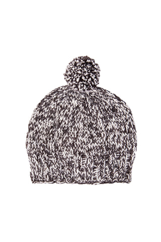Yura Cap by Awamaki. Hand knit in Peru. A timeless, classic fit topped with a pom-pom makes this a perfect touch on any cold weather wardrobe. The cap is handspun on a wooden drop-spindle called a 'pushka.' Color Charcoal. 100% alpaca.