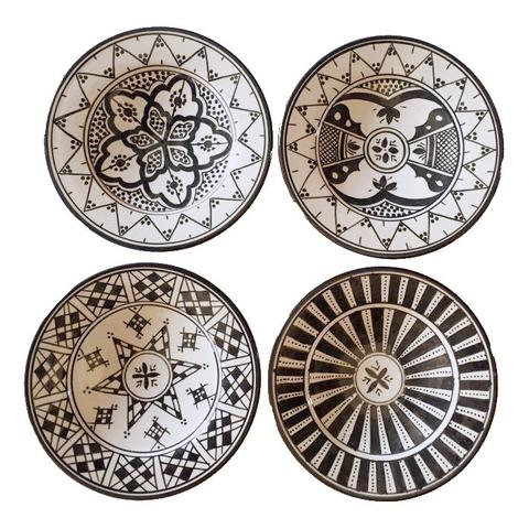 "Handmade in Morocco Safi Plates from Atelier Boemia. Four different and beautifully hand-painted plates (can also be used as wall hanging-holes for wire to be inserted on backside). Available in dinner and appetizer sizes. Handmade in Safi, Morocco. Dishwasher and microwave safe. Measurements Dinner: 25 cm (10"") diameter .Appetizer: 17 cm (7"") diameter."