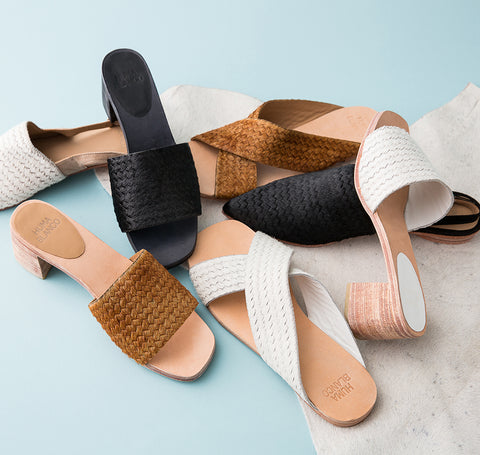 Huma Blanco Spring 2018 Odessa Slide in Caramel. Wide crisscrossed straps fashioned in genuine pony calf hair lend chic texture and visual intrigue to a handmade slide sandal. Color brown. Calf hair upper, leather insole, leather lining, leather sole, and wood heel with leather sole. Sizes 37 38 39.