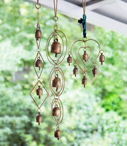 Ushas Dawn Chime by Matr Boomie. Handmade in India. Upcycled metal hanging bell chime displays four handcrafted copper bells in a cascading loop setting with sturdy hanging loop. Handmade by artisans in Buhj, India. Color copper.