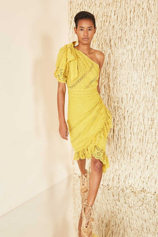 Ulla Johnson Spring 2018 Gwyneth Dress. Floral eyelet puff sleeve midi dress. Scalloped cascade ruffle, shoulder bow detail, hidden side zipper, lined skirt, fitted silhouette. One Shoulder Eyelet Dress features a knee length hem and one- shoulder silhouette. Single short sleeve with bow detail. Wrap style skirt. Asymmetrical ruffle trim midi skirt. Size 4 measures 51 inches from shoulder to back hem. Color Chartreuse. 100% Cotton voile. Sizes 2 4.