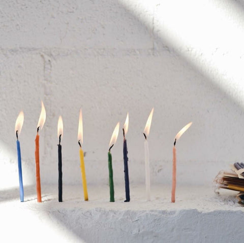 Birthday Candles from Meso Goods. Set of handmade 7 birthday candles from Guatemala. Great for bright cake decoration or as a hand-crafted gift. Available in Violet, Black, White and Pink. Measurements Approx. 4""