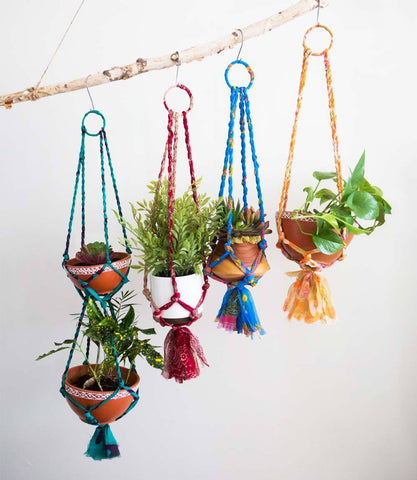 Sari Macrame Tiered Hanging Bowls by Matr Boomie. Handmade in India. Handcrafted terracotta bowls, tiered in an upcycled sari macrame hanger. Made by artisans in Jodhpur, India. Color brown multi.