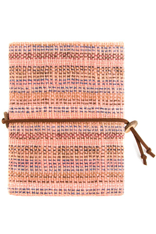 "This Natural Dyed Fabric Journal is wrapped in organic cotton and colored using only natural dyes. The journals are handmade by artisans on the Thai-Burmese border and are designed with a subtle striped pattern. The Natural Dyed Fabric Journal is fastened with a suede string and unique coconut shell pieces. Available in Light Blue and Rose. Small Large. Organic naturally dyed cotton cover Un-ruled paper 4""W x 5½""H x 1""D"