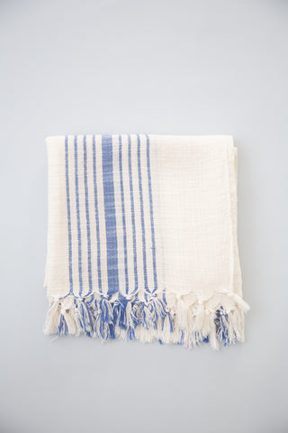 Hudson Towel by Home & Loft. Handwoven in Turkey. These Turkish cotton towels, also know as Pestemals, are known for their comfort, durability, and absorbency. They are suited for everyday use and require less space, drying time, and laundering than a terrycloth towel. Color white blue. 100% cotton.