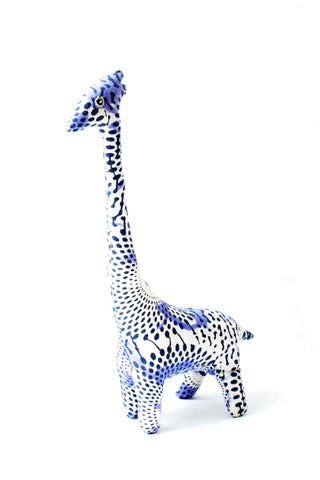 "Safari Giraffe from Indego Africa. Indego Africa's take on the stuffed animal, this patterned giraffe is filled with recycled fabric and sealed with love. Used as a bookend, toy, or decorative object, this piece is sure to bring the perfect touch of Africa to your home.  5"" x 10"" All profits fund educational training programs for the women that handcraft Indego Africa's products."