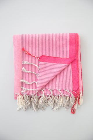 Ibiza Towel by Home & Loft. Handwoven in Turkey. These Turkish cotton towels, also know as Pestemals, are known for their comfort, durability, and absorbency. They are suited for everyday use and require less space, drying time, and laundering than a terrycloth towel. Color pink. 100% cotton.
