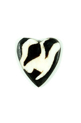 Bone Heart Tokens by Swahili Modern. Hand carved in Kenya. These smooth, durable hearts are fun to touch and lightweight, making them ideal to carry as a love token. Kenyan artisans carefully carve these beautiful keepsakes from all-natural cow bone and apply a dyed finish by hand. Each heart is completely unique. Color black. 100% upcycled bone.