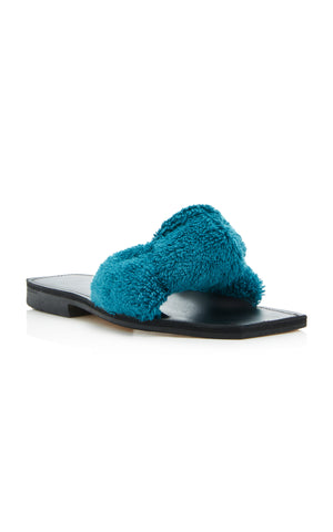 Parme Marin Spring 2018 Node Slide in Duck Blue. Knotted terry cloth slide with leather footbed. Square open toe slide sandal. Dust bag included. Color Teal. Terry cloth upper. Lambskin footbed. Sizes 36 37 38 39 40.