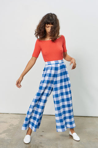 Mara Hoffman Spring 2018 Angie Pant. 100% organic cotton woven by artisans in India. Gingham pattern pant with buttons on the sides. High waist culottes with button sides seams in blue and white crinkled plaid. Pleated at front and back waist with extra wide pant legs. Textured weave, wide leg cut and cropped profile. Lined. Size 4 has 23.25 inch inseam. Color blue and white check plaid. 100% cotton. Sizes 0 2 4 6.