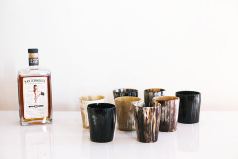 Ankole Horn Whiskey Tumbler Set by Rose & Fitzgerald. Handcrafted in Uganda. These ethically sourced cow horn whisky tumblers are the perfect accompaniment to your favorite single-malt whiskey. Valued for both its hardness and its ability to become soft and pliable when heated, Ankole cattle horn has been used by East Africans for centuries. Color black. 100% ankole cow horn.