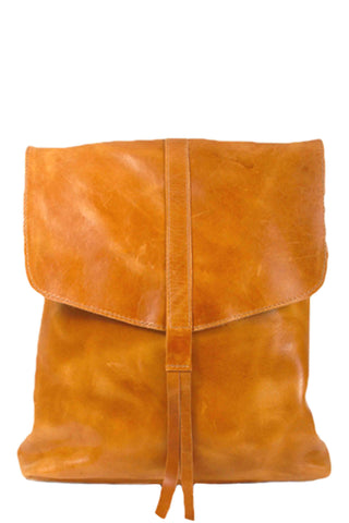 Raven and Lily's Yami Brown Leather Backpack. This locally-sourced Ethiopian leather backpack is a must-have everyday accessory. Small inside pocket. Magnetic closure under the flap. Two thin leather straps. Leather tassel detail. Unlined vegetable dyed leather. Handmade by women in Ethiopia. Color brown. 100% leather. Measures 12.5 inches by 11 inches. 4 inch gusset. 27 inch straps. One size.