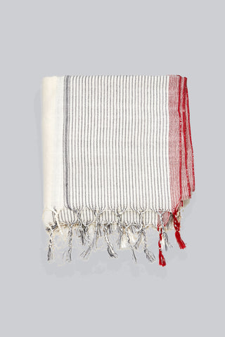 Tribeca Towel by Home & Loft. Handwoven in Turkey. Pestemals are known for their comfort, durability, and absorbency. They are suited for everyday use and require less space, drying time, and laundering than a terrycloth towel. Color natural. 100% cotton.