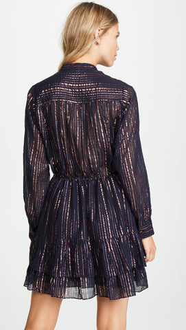 Ulla Johnson Spring 2018 Della Dress. Striped Copper Lurex mini dress with open placket front and elastic waist. Ruffle detail on skirt. Button closure at cuffs. Tonal metallic stripes. Drawstring side ties at waist. Long sleeved mini dress. Henley style button up neckline. Lined. Color Midnight. 95% cotton 5% lurex. Sizes 0 2 4 6 8.
