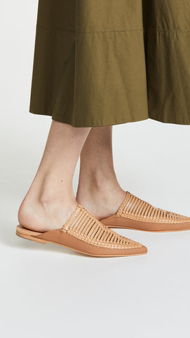 Ulla Johnson Spring 2018 Jana Babouche in Latté. Traditional Moroccan babouche. Hand-braided leather, pointed toe, slight heel. Inspired by Serbian Opanci. Pointed toe mule. Rubber heel patch at leather sole. Color Tan. 100% Leather. Sizes 36 37 38 39.