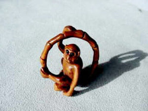 Swingin Carved & Signed Boxwood Monkey Ojime/Netsuke Bead | 22x21x11m | Brown - PremiumBead
