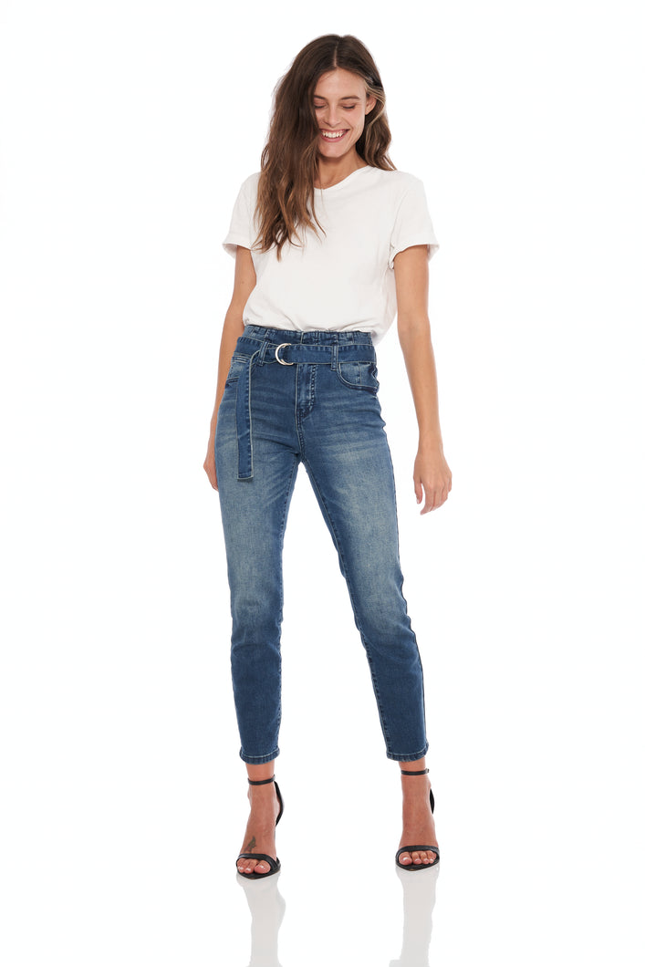 High rise slim fit belted stretch jean in medium blue. Self fabric belt with silver d-rings.