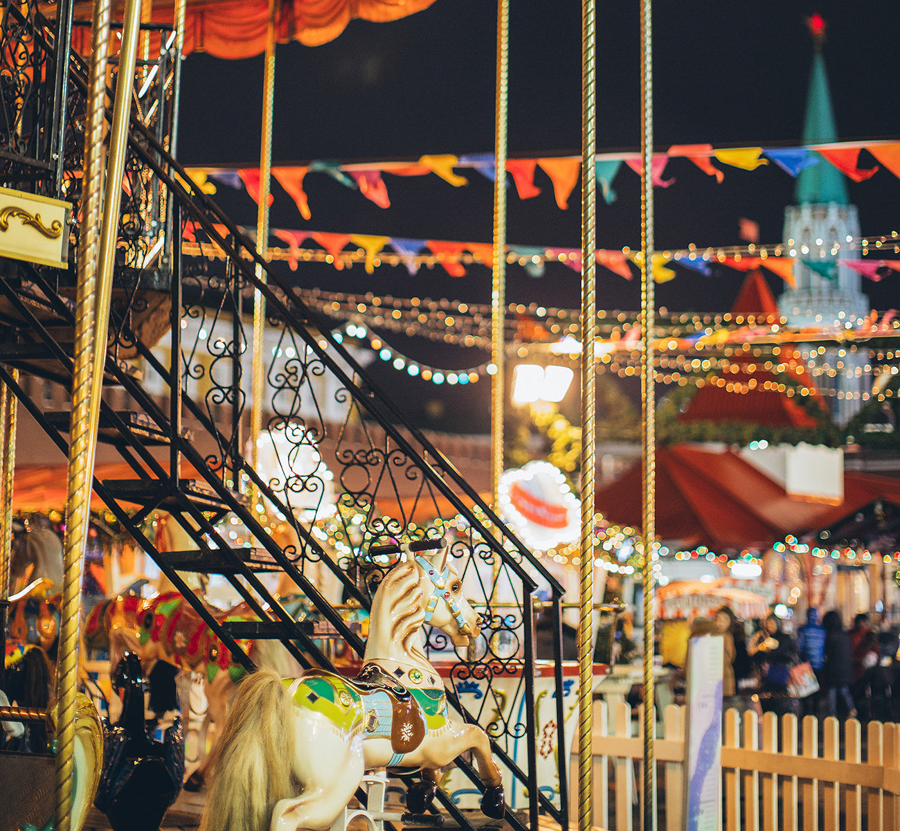 Colourful carousel at night