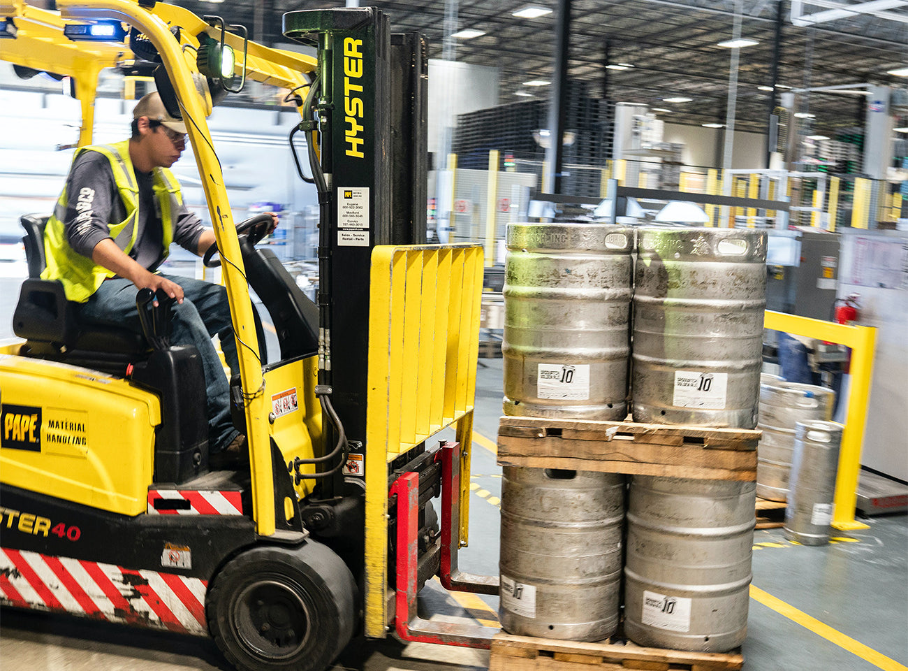 Man driving a forklift around a warehouse