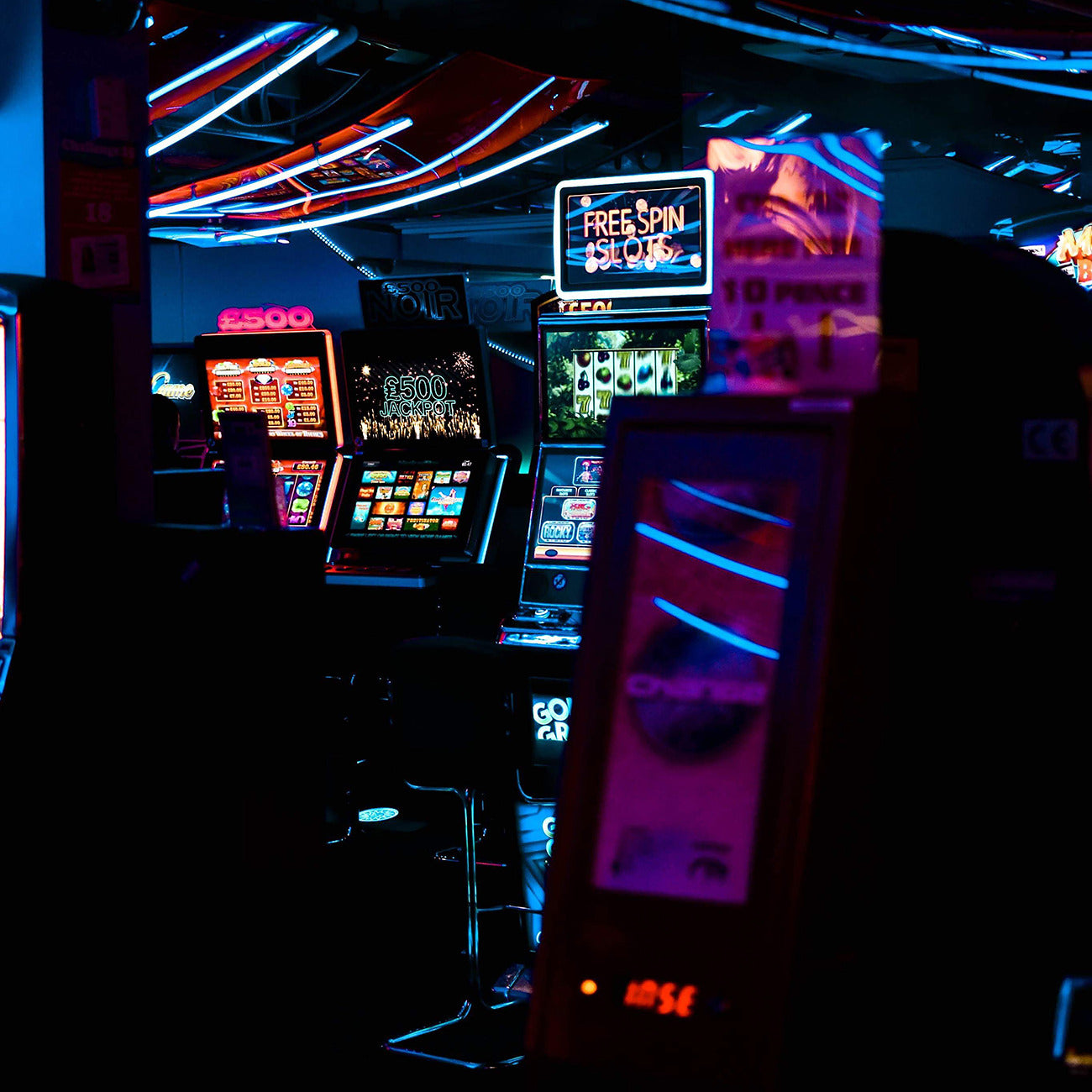 Casino machines lit up in a dark room