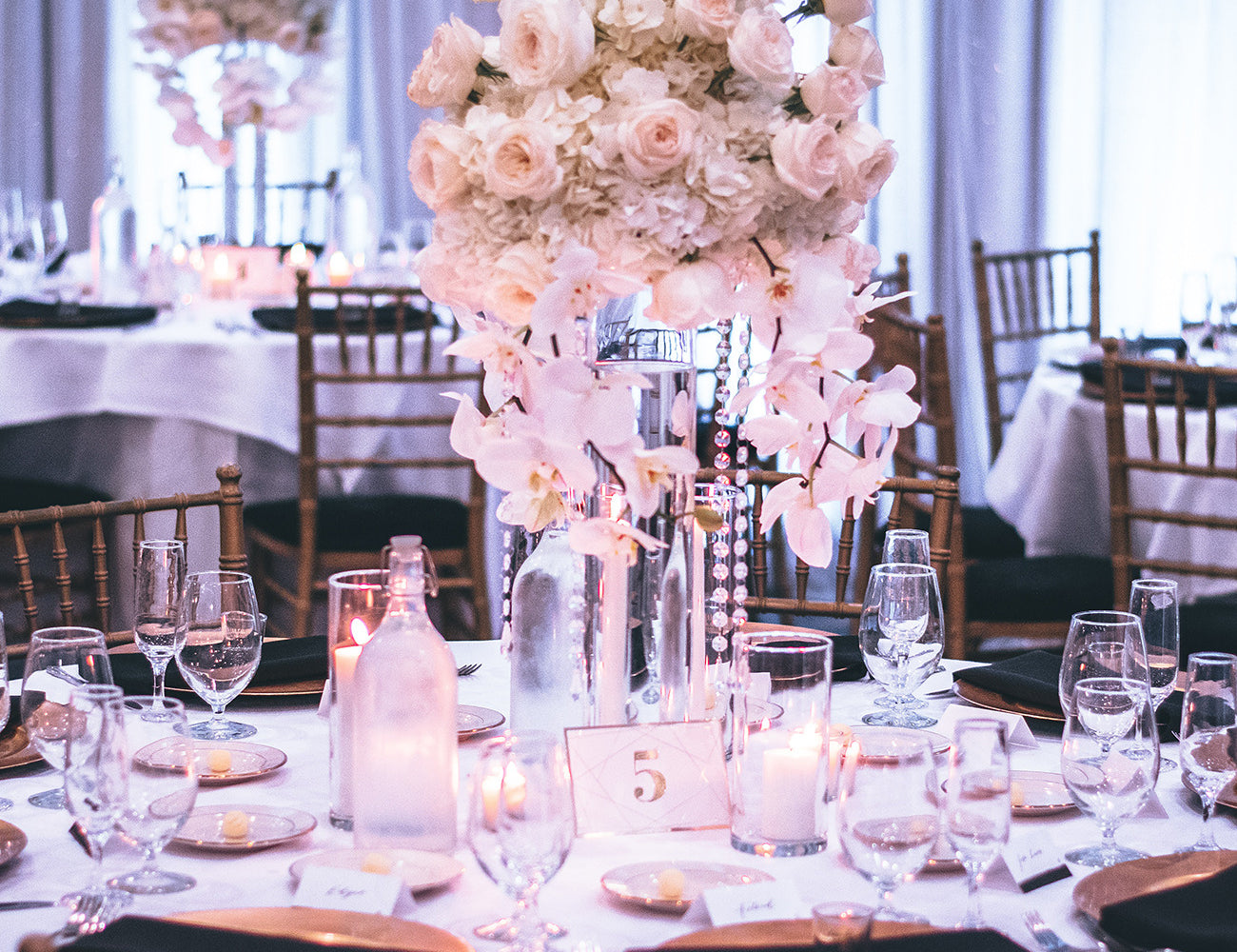Dining table with a rose centrepiece in a banquet hall