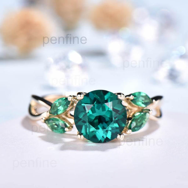 Vintage Emerald engagement ring round cut