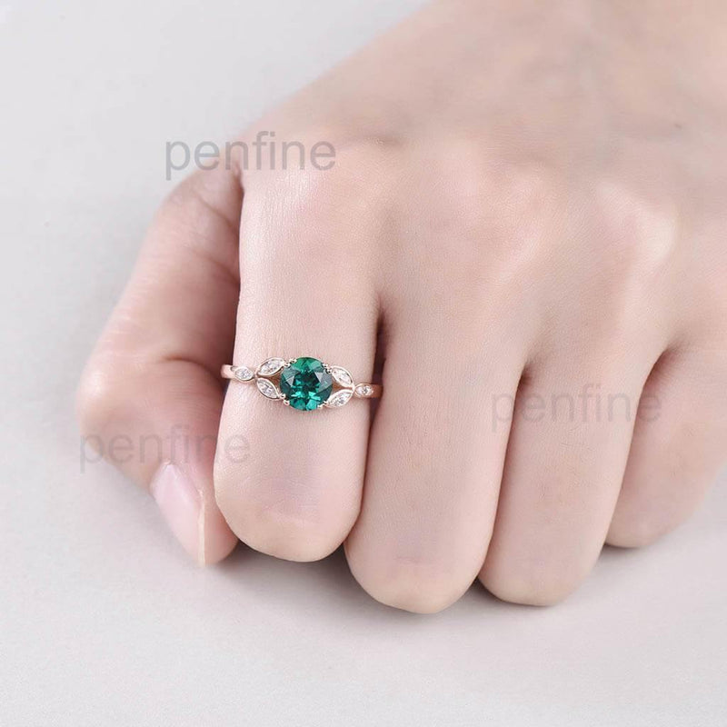 Leaf Emerald Engagement Ring In hand
