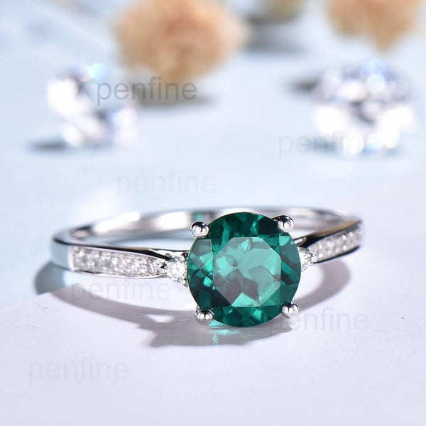emerald engagement ring white gold