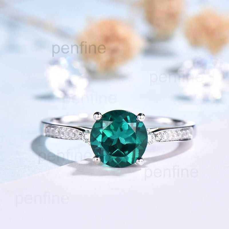 channel set emerald engagement ring