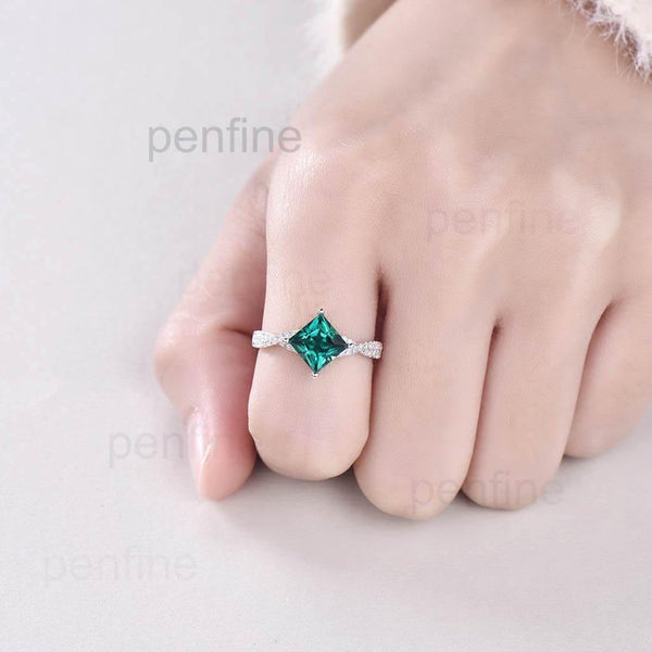 Princess Cut Emerald Engagement Ring In hand