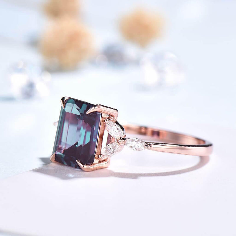 Emerald cut Alexandrite engagement ring rose gold side