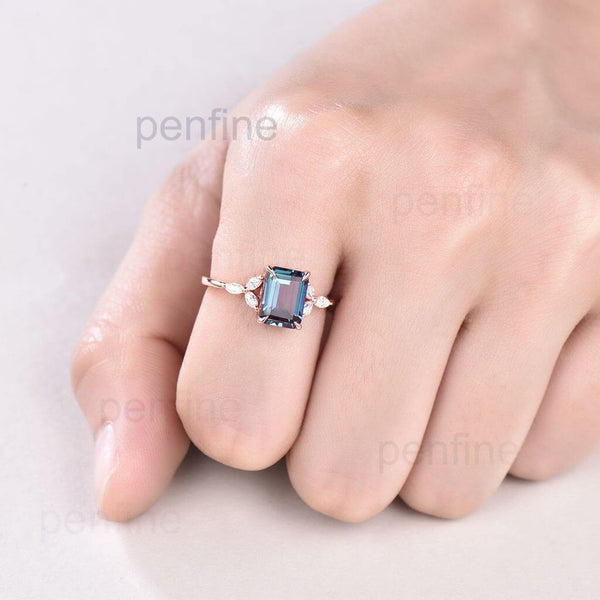 Emerald cut Alexandrite engagement ring rose gold in hand