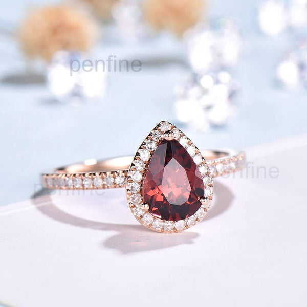 pear garnet engagement ring