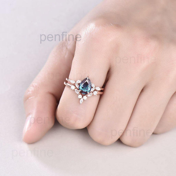 pear shaped alexandrite engagement ring set in hand