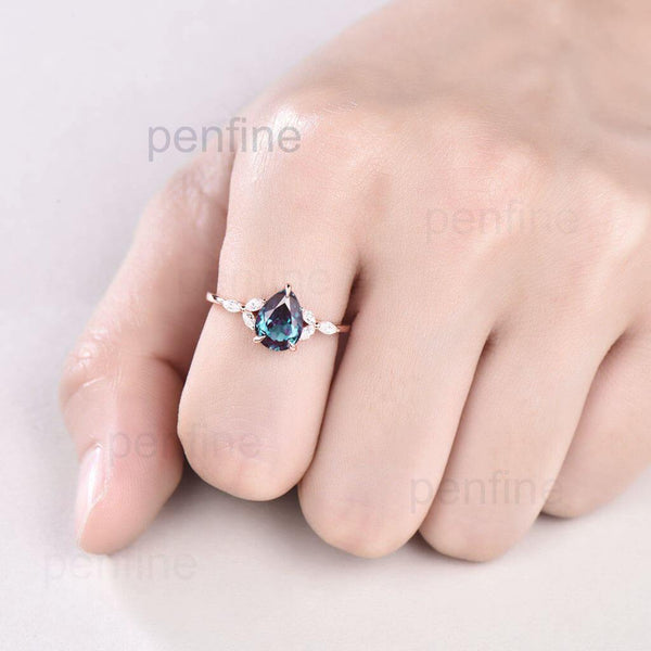 pear shaped alexandrite engagement ring hand
