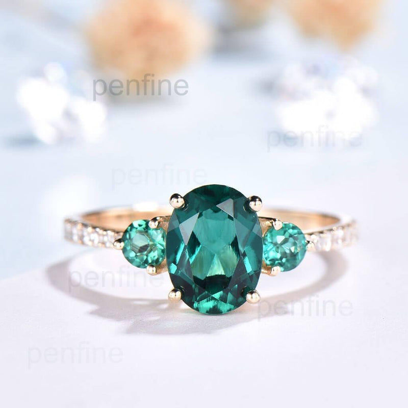 Three stone Emerald Engagement Ring Yellow gold
