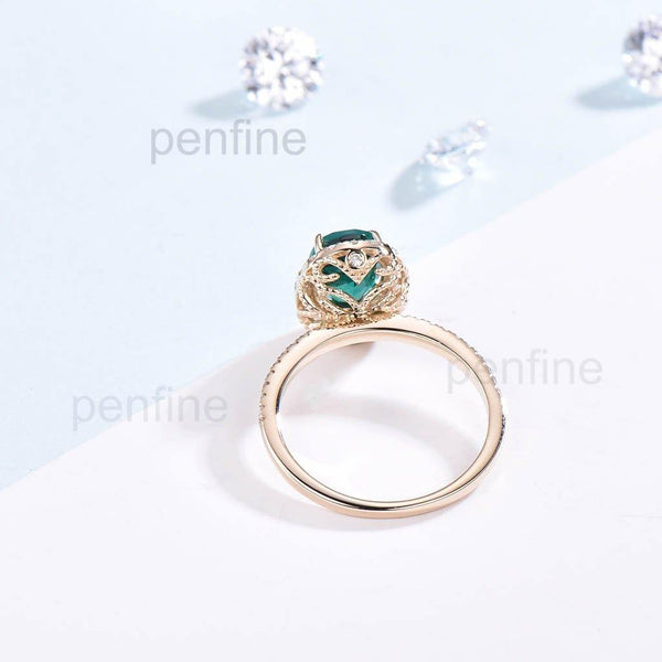 emerald engagement ring floral
