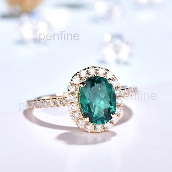 Diamond Halo emerald engagement ring