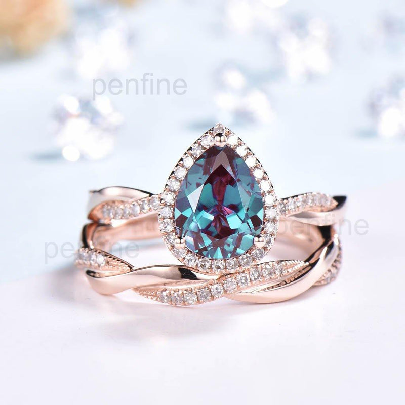 infinity pear shaped alexandrite engagement ring set