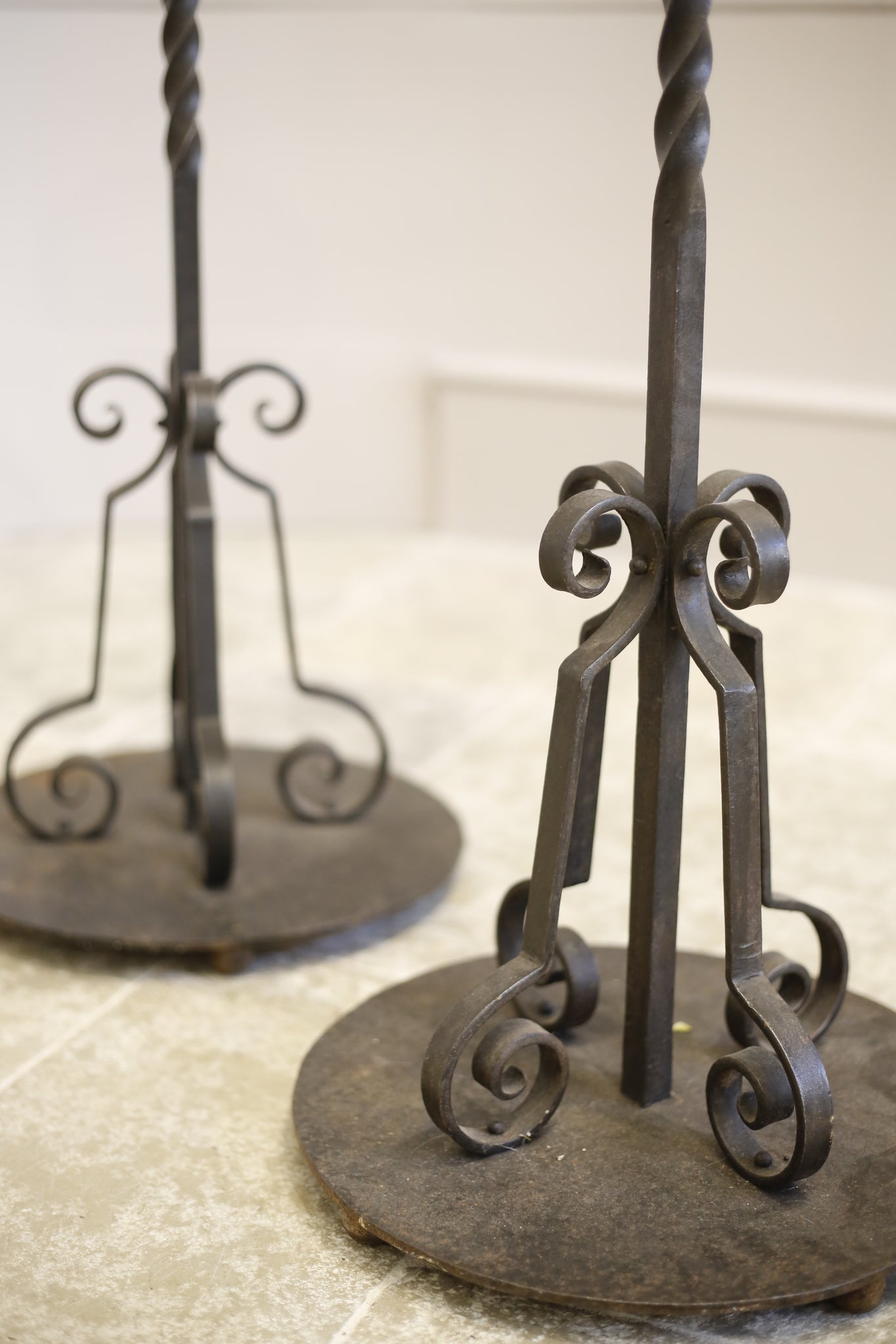 Pair of Iron and copper Arts and Crafts candlesticks